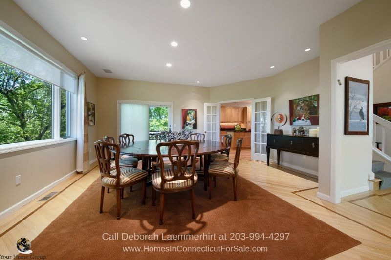 New Fairfield CT Real New Fairfield CT- The formal dining room of this home in New Fairfield CT is perfect for large gatherings, intimate dinner parties, and celebrations.