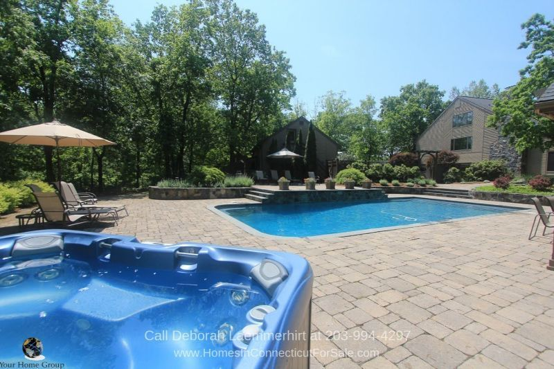 Homes for Sale in New Fairfield CT - For outdoor relaxation, this New Fairfield CT home has a patio and a pool where you can swim, soak, and relax to your heart's content.
