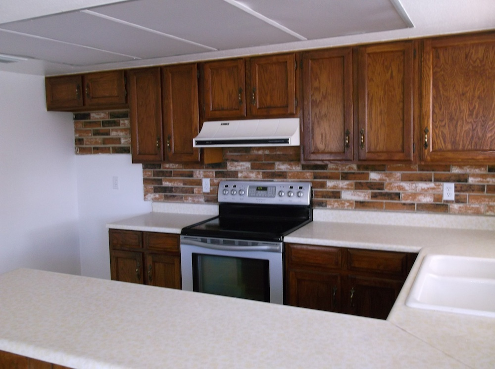 1970s phoenix house for sale with stained cabinets and original pulls in kitchen area with counter space