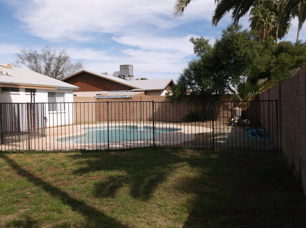 pool and grassy area of 1970s phoenix house with sale with no HOA