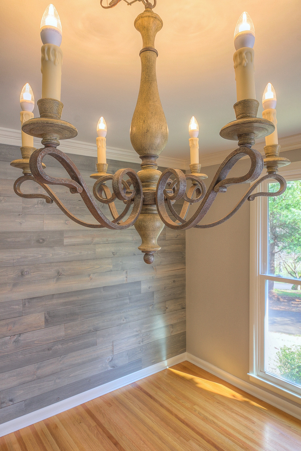 Closeup Detail of the Designer Chandelier and Reclaimed Wood Wall