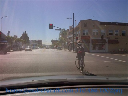 bicyclist in front of Los Angeles Realtor Endre Barath