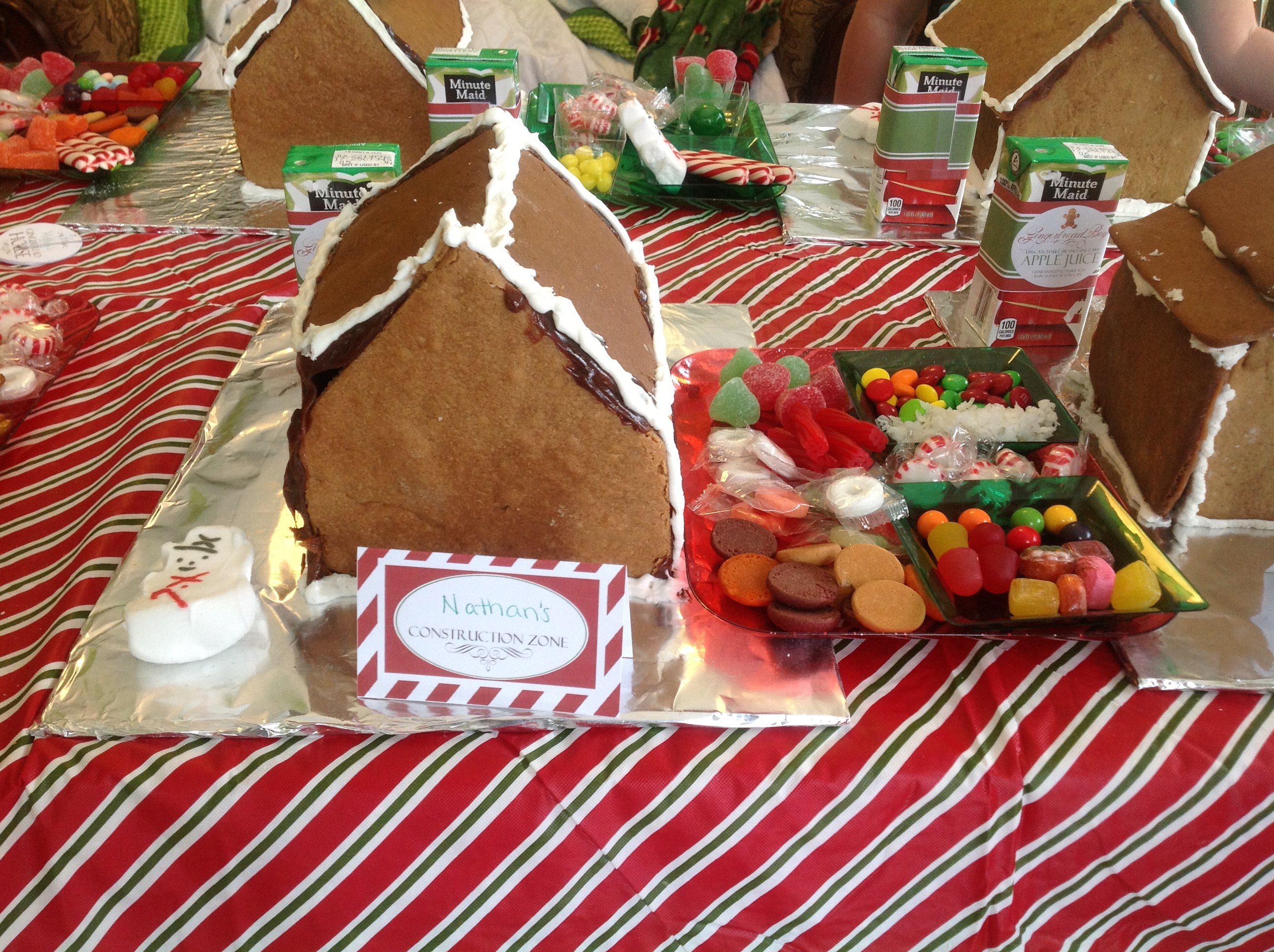 photo of gingerbread house, name tag and candy dish