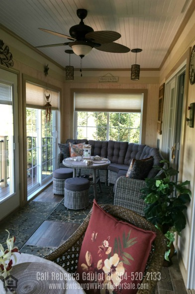 Real Estate Properties for Sale in Lewisburg WV - Relax and enjoy the view of your backyard during any season in the sunroom of the Lewisburg home.