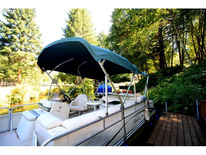 Our pontoon on our lot for sale 9857 Beach Drive