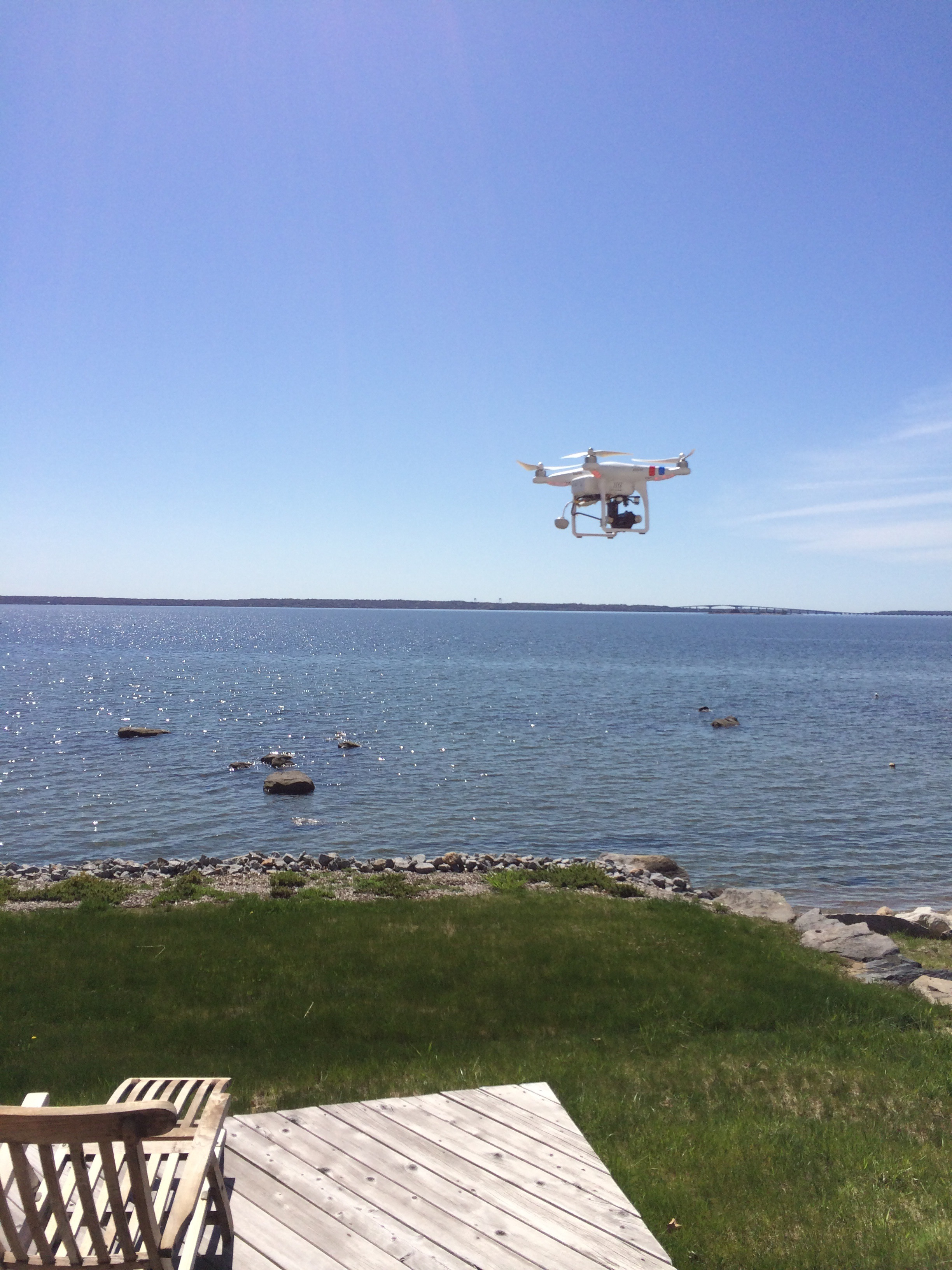 drone in RI coastal real estate filming