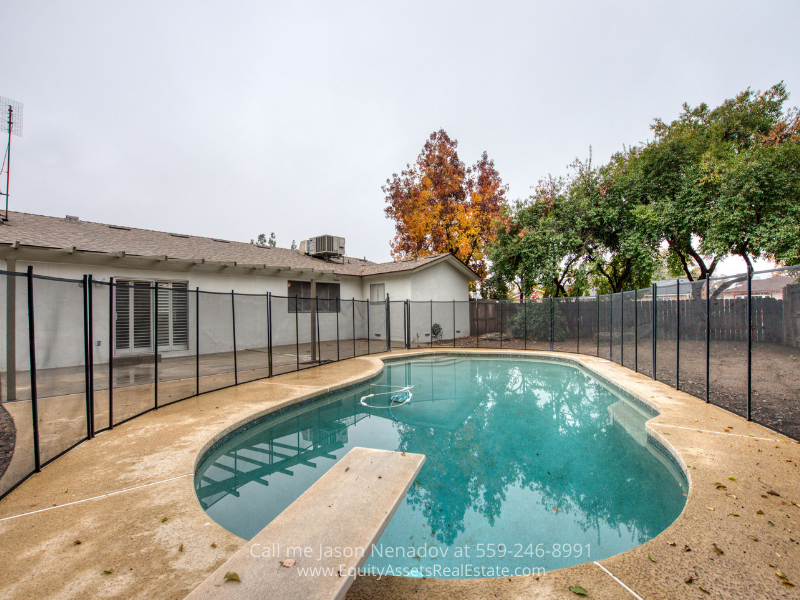 Clovis CA home- Keep your body healthy and boost your mood with the pebble tec pool of this Clovis CA home.