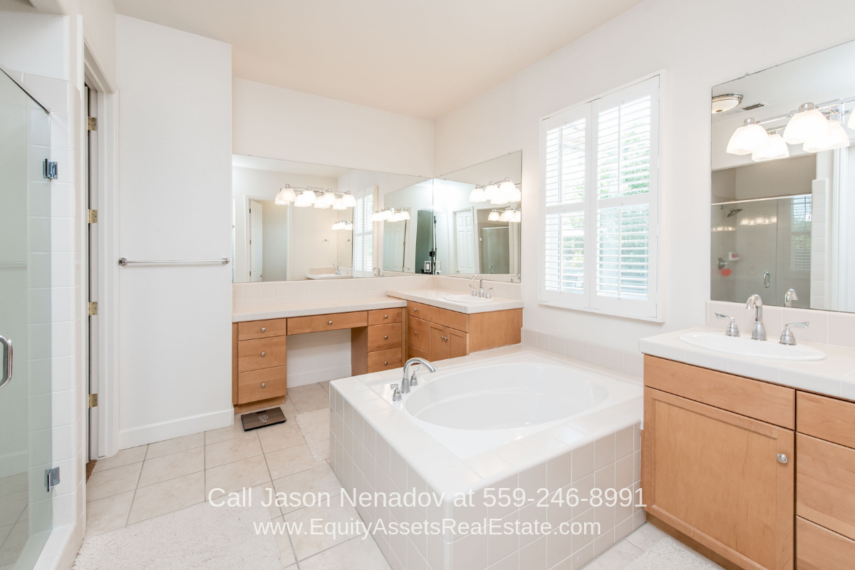 Homes in Clovis CA - Look forward to long warm relaxing soaks in the Jacuzzi tub of the master bathroom of this beautiful pool home for sale in Clovis CA.