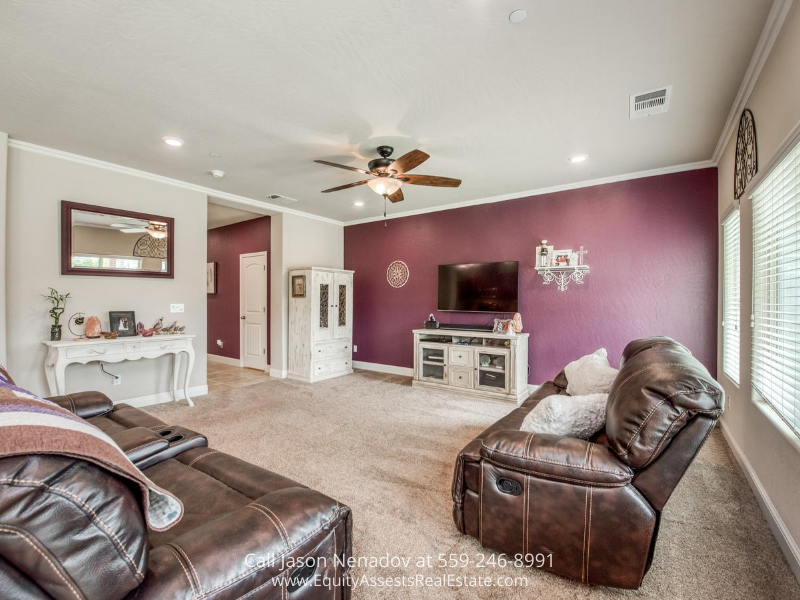 Clovis CA home- Relax and unwind in the bright and spacious living room of this Clovis CA home.