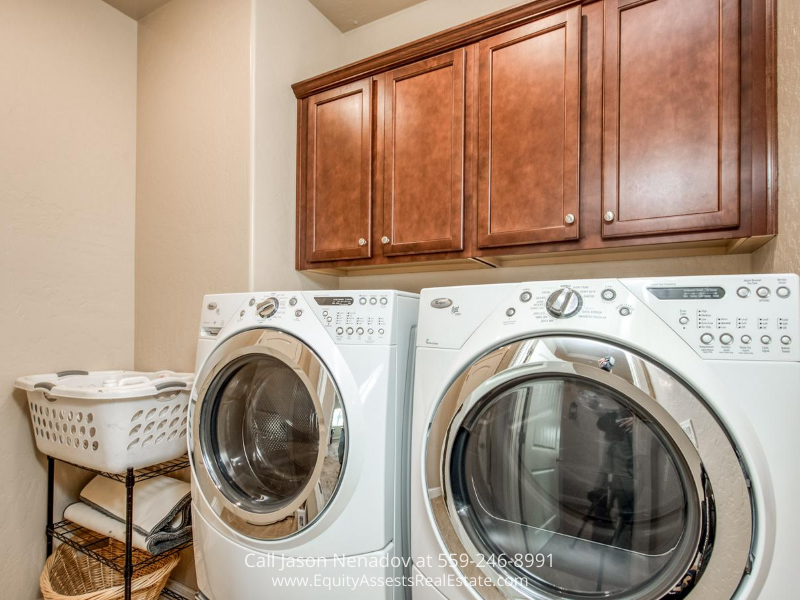 Clovis CA real estate for sale- This Clovis CA home for sale has a dedicated laundry room.