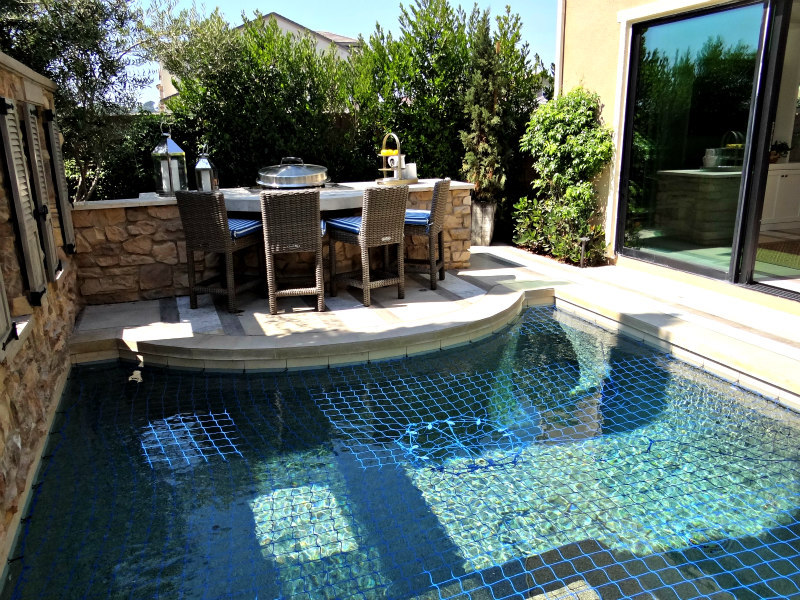 Carlsbad outdoor dining and a pool
