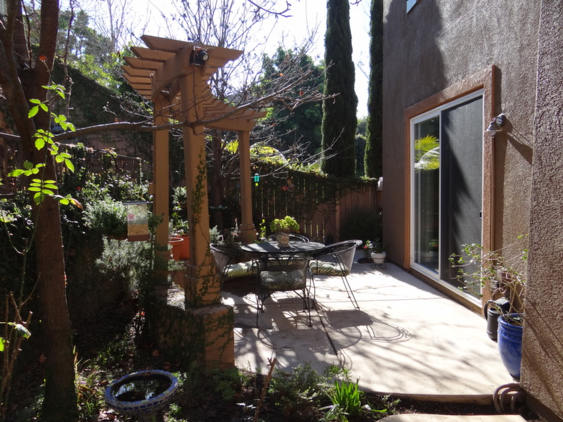 Beautifully landscape garden and patio area at rear of home