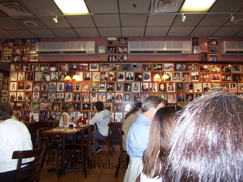 Photos on the wall at Carnegie Deli