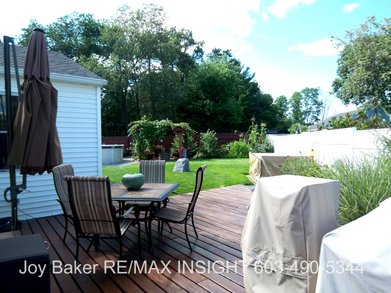 90 Allamimo St Manchester NH 03102 Deck and Yard Joy Baker RE/MAX Insight 603-490-5344