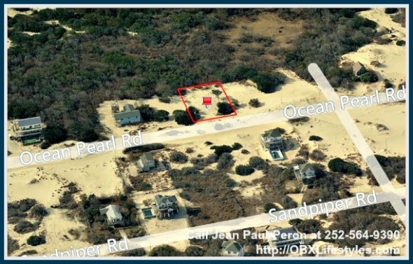 This lot for sale on the OBX NC has few surrounding homes that makes it a perfect location for your dream beach home.