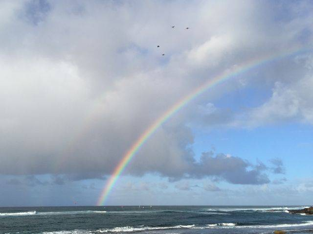 rainbow at Ho'okipa Beach, Paia Maui HI