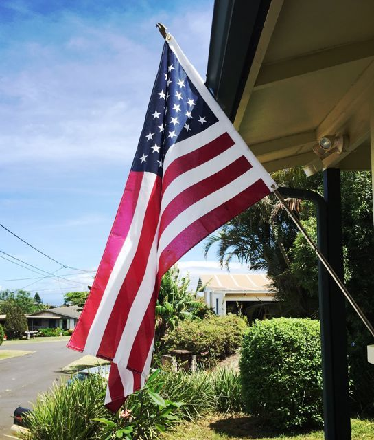US flag on a front porch in Paia Maui HI