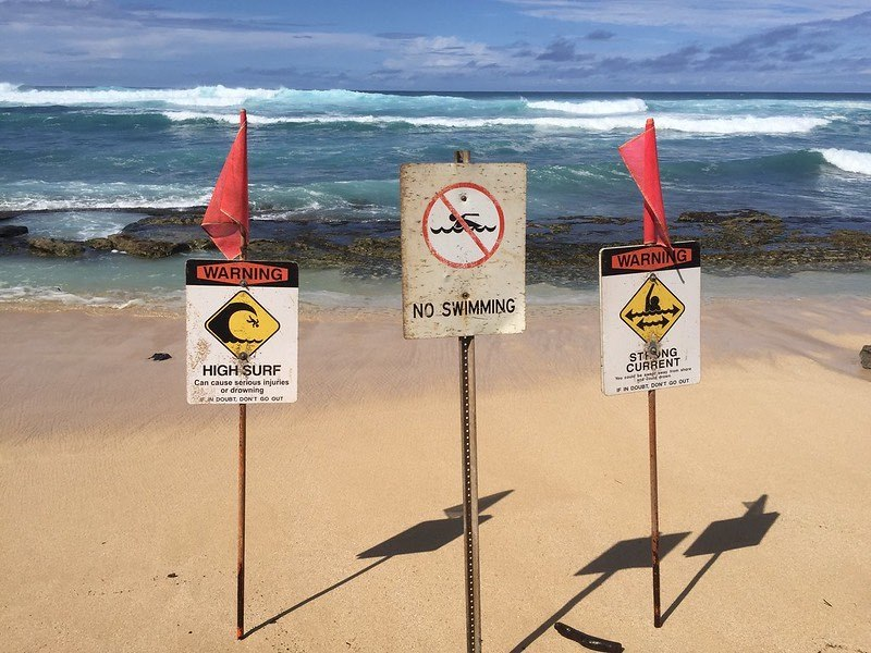 High surf warning signs - Ho'okipa Maui HI