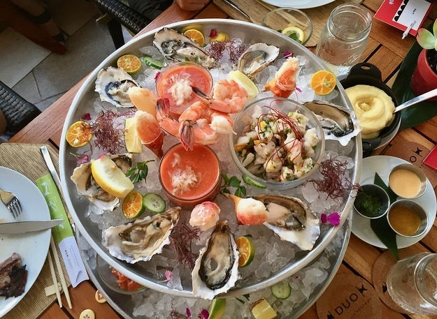 The Seafood Tower includes oysters, poke, ceviche, prawns, crab and lobster!
