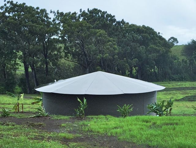 Rainwater catchment tank with hard cover in Haiku Maui