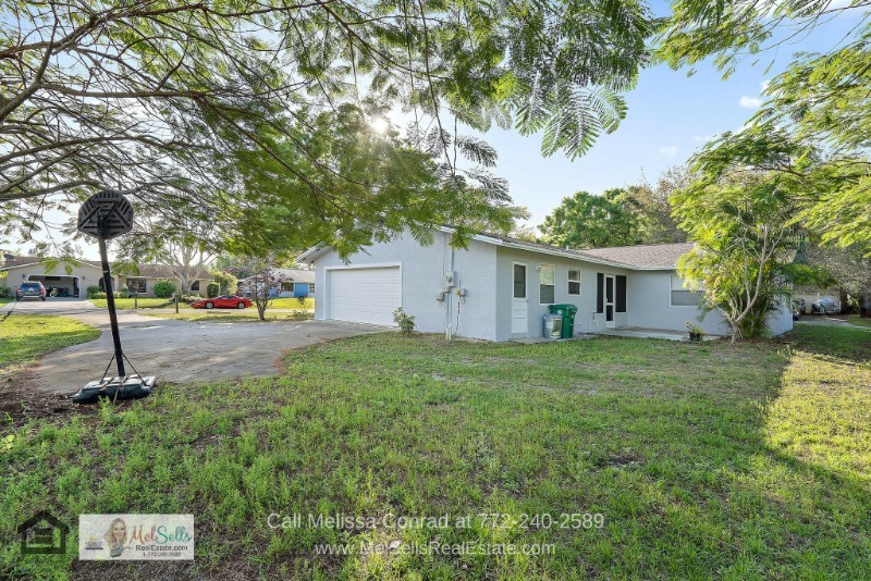 Port St. Lucie FL Homes - A lovely outdoor retreat awaits you in this Port St. Lucie home for sale.