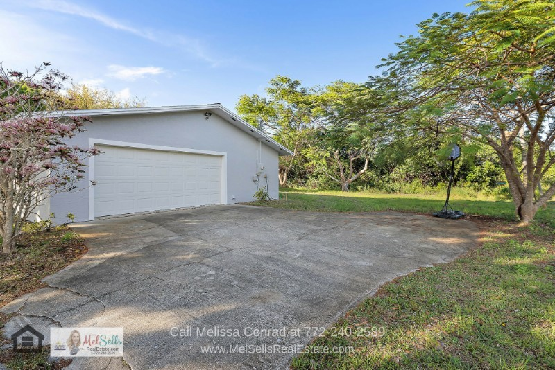 Real Estate Properties for Sale in Port St. Lucie - Enjoy the flexible living space offered by the attached 2-car garage of this home for sale in Port St. Lucie.