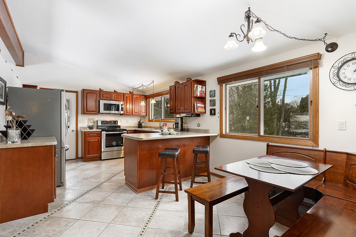 Remodeled Kitchen with Stainless Steel & Cherry Cabinetry