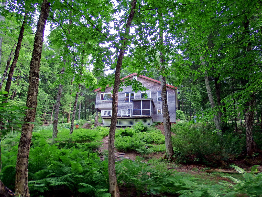 home for sale with land in Maine on river photo