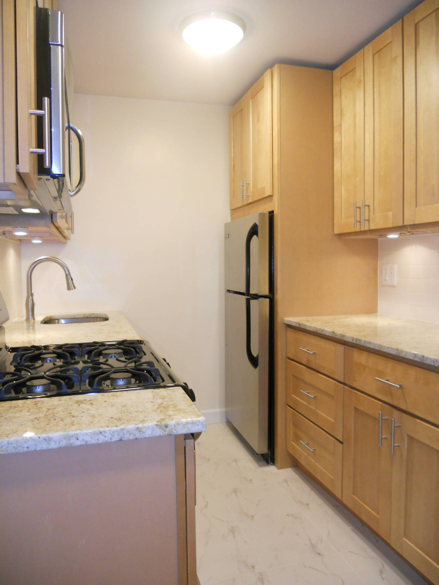 Renovated Kitchen for One Bedroom Condominium for Rent at Dorchester Towers