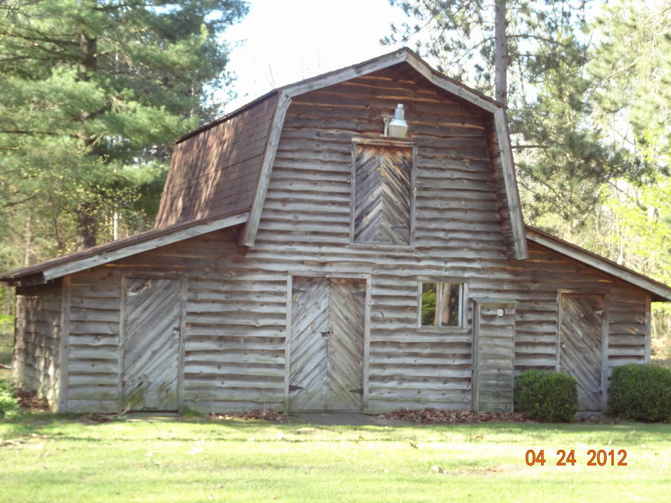 Saugatuck area log homes for sale by dee dee hanson for Log pole barn