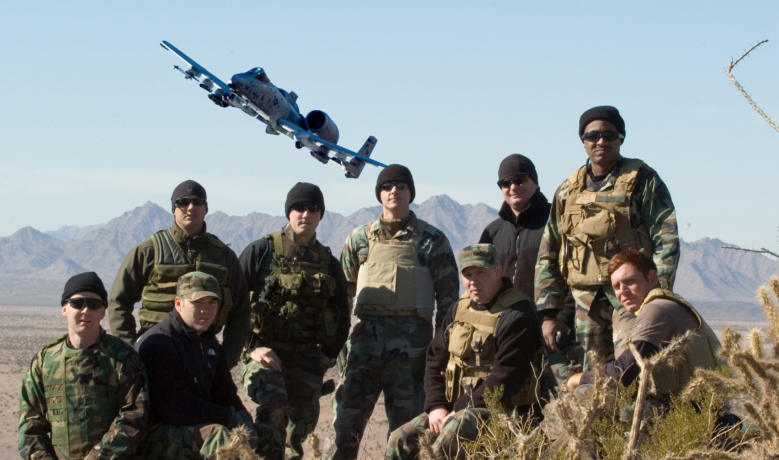 military photo with A-10 in the background