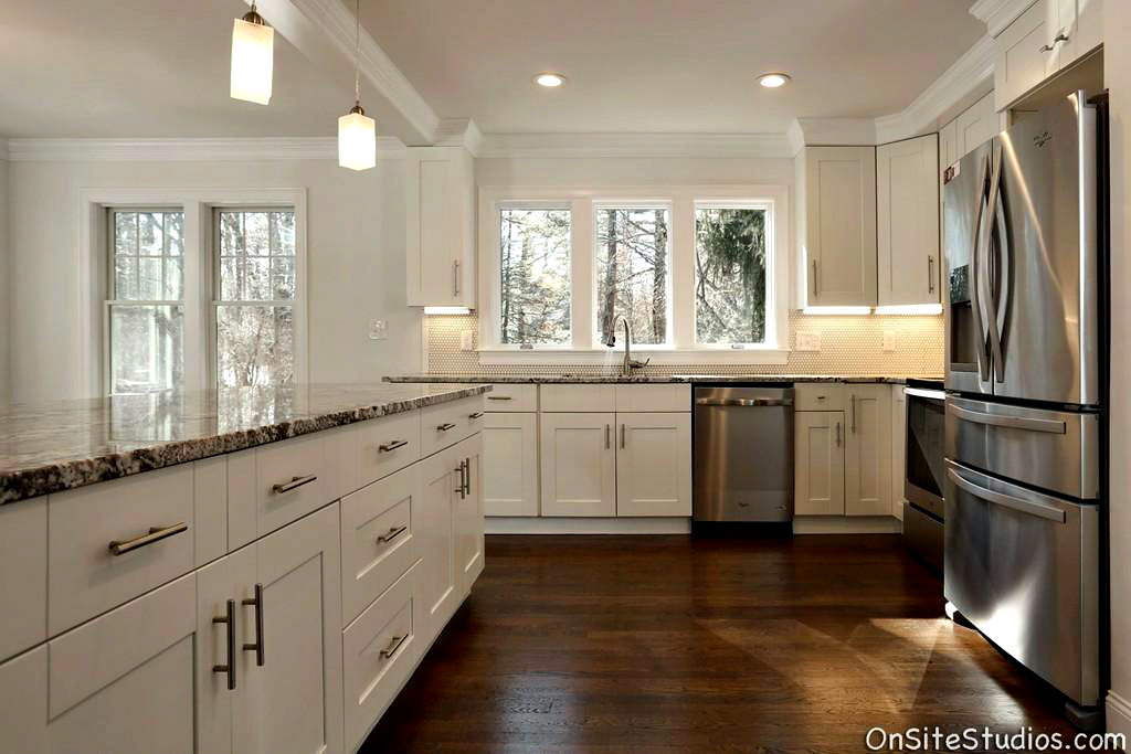 Shaker Style Cabinetry and undercabinet lighting show off the beautiful granite counters