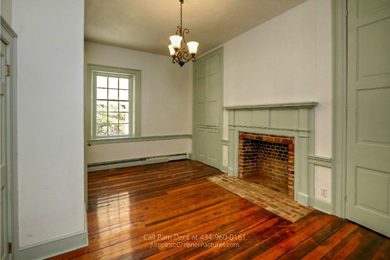 Historic Country Estates in VA - The spacious master bedroom on the main floor of this historic county home offers privacy and personal space.