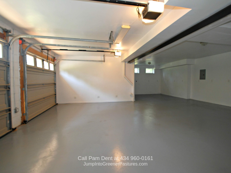 Real Estate Properties for Sale in Charlottesville VA - The oversized garage of this Charlottesville VA home offers ample space and storage.
