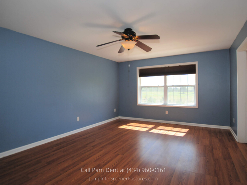 Country Properties in Central VA - Enjoy peaceful nights and gorgeous views in the large master bedroom of Palmyra Hill, a Central VA farmette for sale.