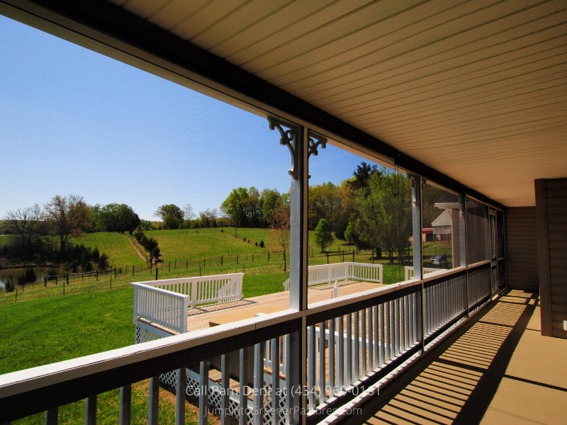 Country Properties for Sale in Central VA - Love having friends over? The large and airy screened porch of this Central VA home is the perfect place to entertain!