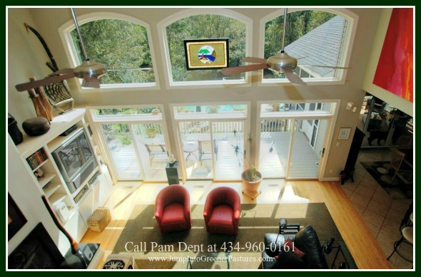 Scottsville VA High-end Homes for Sale - The living room of this country home in Central Virginia, with its large glass walls, is dramatic and impressive.