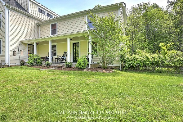 Country Property for Sale in Central VA - Stunning views await you on the side porch of this elegant Central Virginia country property.
