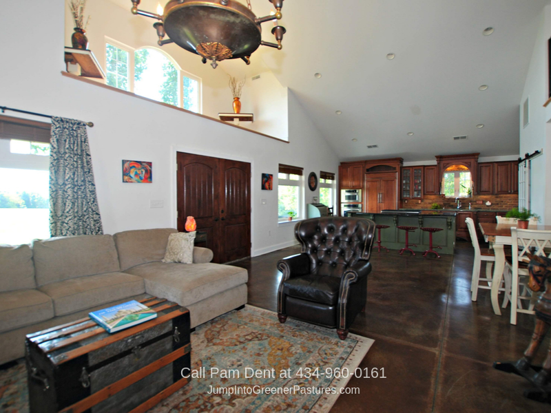 Virginia Horse Farm for Sale - Relax in the light-filled great room of this Virginia equestrian property.