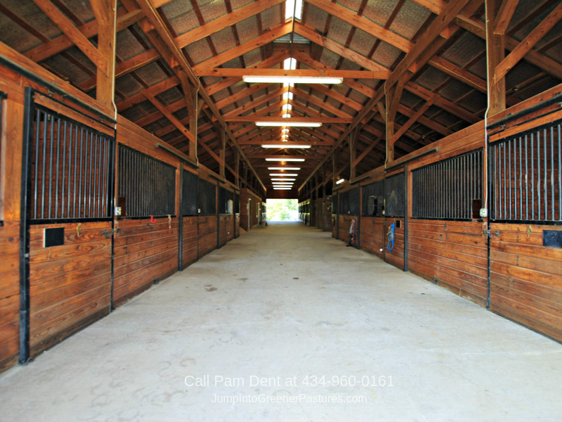 Virginia Horse Farms - The well-designed 24-matted stall barn of this Virginia horse farm offers ample space and protection for your horses and equipment.