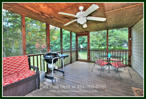 Central Virginia Historic Real Estate Properties for Sale - The best of rest and relaxation are yours on the enclosed porch overlooking the vast backyard of this historic home for sale in Central Virginia.