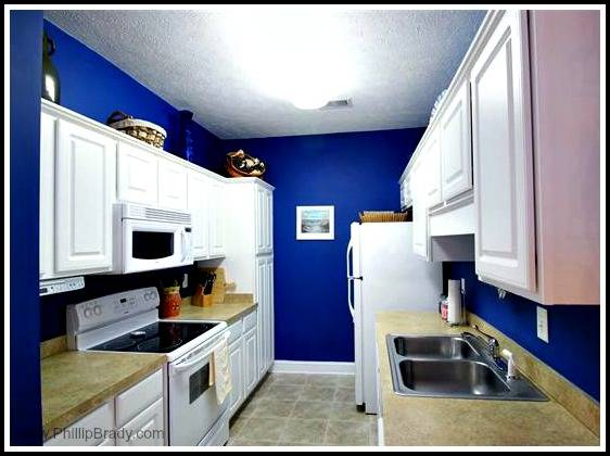 The spotless kitchen of this condo for sale in Pawleys Island has ample storage and complete appliances.