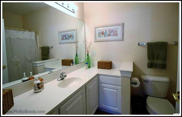 This Pawleys Island condo for sale's master bathroom is designed for your comfort and convenience.