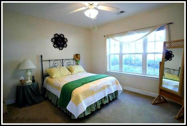 The master suite of this Pawleys Island condo for sale has oversized windows to allow plenty of natural light to enter.
