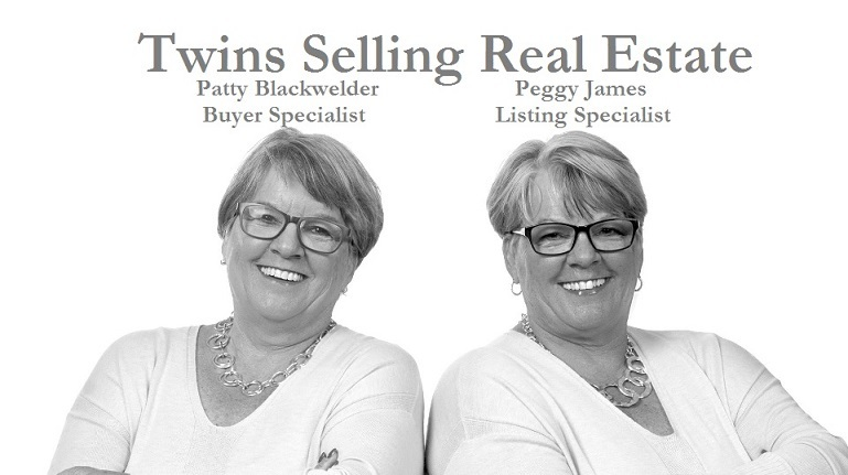 Twins Selling Real Estate
