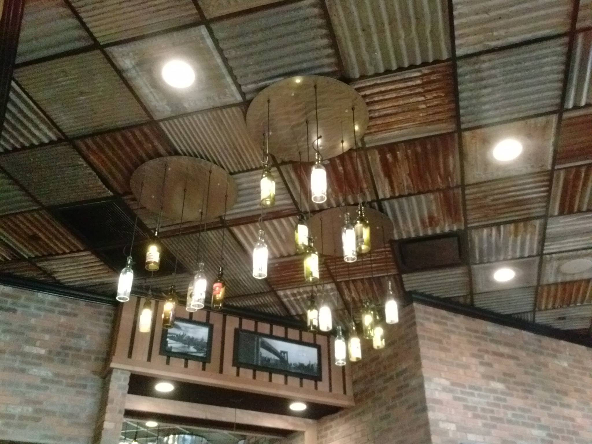 Corrugated Steel And Wood Ceiling In Kitchen
