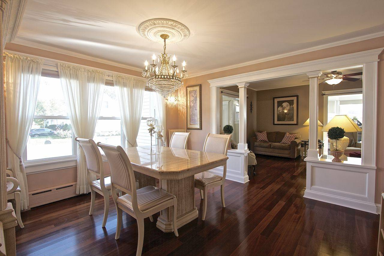 Dining room with new gleaming hardwood floors vision pointe homes - This Charming 3 Bedroom Colonial Boasts Peruvian Cherry Hardwood Floors Throughout The First Floor And Custom Mouldings Between The Living And Dining Room