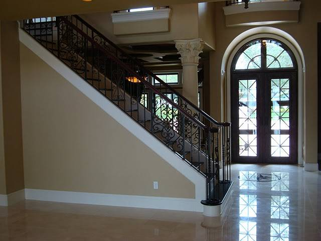 Custom home building tips stairway and foyer remodel for Custom home building tips