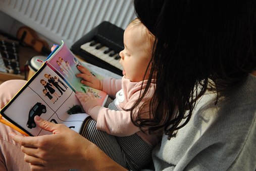 Mom baby reading book image