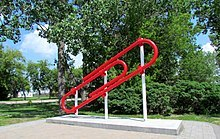 red paperclip statue image